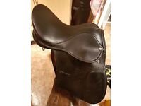 17' wide black saddle. Good condition. Would be good for breaking in or general use at home.