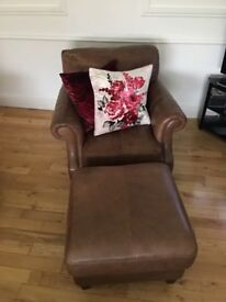 Antique brown leather chair and footstool
