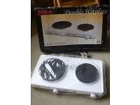 Double cooking hot plate. White. Brand new - never used. Measures 48x26cms