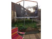 12 ft trampoline with enclosures emaculate only 6 months old
