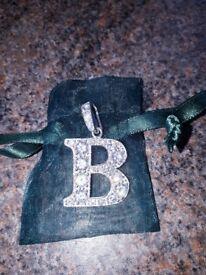 B silver hallmarked pendant.