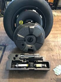 Bmw new space saver spare wheel with complete boot kit , jack brace boot support etc. Mallusk