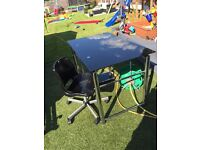 Stylish black glass top desk with swivel chair only used for 12 months