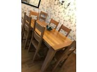 Oak dining table and 8 chairs