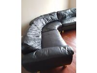 Black leather curved sofa