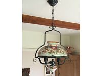 Wrought iron and porcelain ceiling light fitting