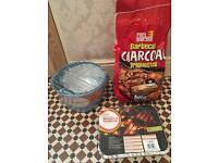 Barbecue bucket and coals