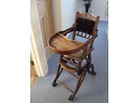 Antique Wooden Childs High Chair made around 1900's. Colapses down to a rocking chair