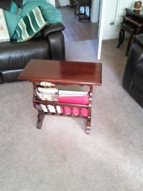Magazine rack with table top. Dark wood.