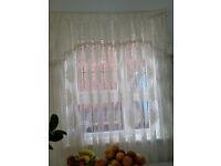 2 thin Windows curtains
