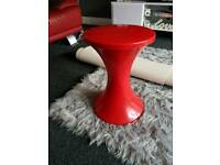 Small red plastic stool/table