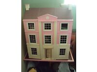 LARGE PINK WOODEN DOLL HOUSE ,WITH FURNITURE / PEOPLE