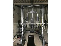 Smith Machine, Spin Bike, Weights, Bars