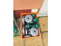 Assorted weights with Bar and dumbbell bar