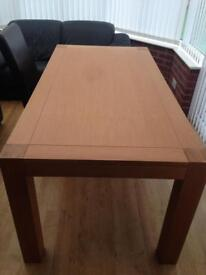 Lee Longlands wooden table and six leather seats