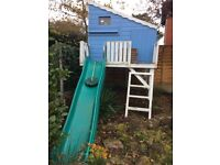 Tree House with slide. On stilts and in tip top condition. Originally from B and Q.