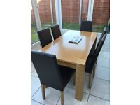 Solid Oak 6 seater dining table and chairs