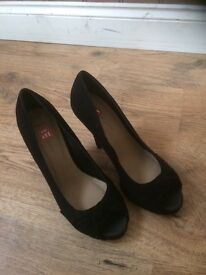 Black suede open toe shoes. Brand new never worn. Size 7 stiletto heal