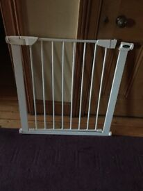 Child gate - hardly used. Standard door size.