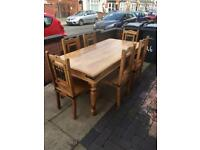Lovely solid pine dining table with 6 great chairs