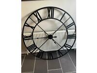 large metal wall clock in black