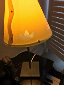 A pretty bedside lamp with pewter base