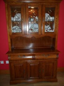 Display Cabinet. In Excellent Condition. An Interior Light, Top Doors Has Ornamental Lead Glass.