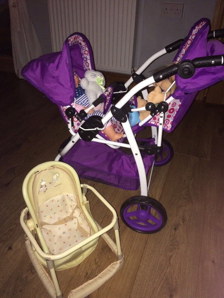 Dolls pram with 2 dolls and baby walker