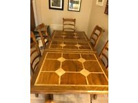 Elegant Dining Table and Matching Chairs