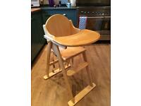 Wooden high chair with straps