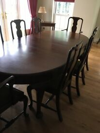 Antique dining table and 10 chairs, matching sideboard,