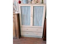 Vintage / retro painted cabinet with drawers was used as a tv cabinet