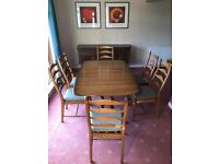Ercol Dorchester Extending Dining Table and 6 Ercol Penn Ladderback chairs