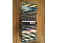 25 assorted CD's in good condition and original packaging