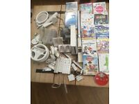 Wii console complete with 12 Games and all accessories +Wii fit Board