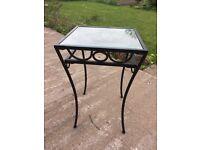 Black wrought iron table