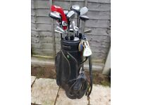 Set of assorted golf clubs and bag