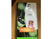 2 pack genuine HP 301 black plus colour printer ink. HP photo paper and envelopes included