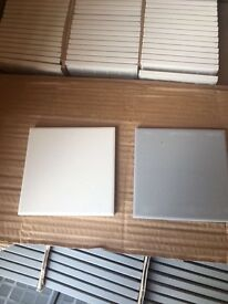 Grey/ cream wall/floor tiles