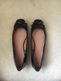 Black patent ballet pumps
