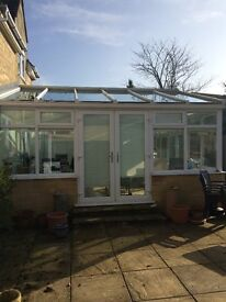 Used UPVC Conservatory with French doors. Buyer must dismantle and collect .