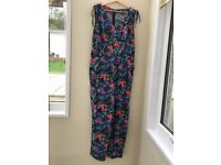 Beautiful and bright new .. never worn jumpsuit size 16