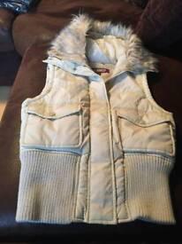 Cream gilet with fur hood size 10