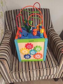 Children's wooden activity cube with storage