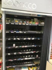Cigarette stand for retail outlet