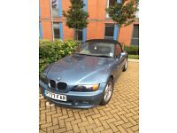 BMW Z3 (1997, Atlanta blue with tan interior and black seats, electric windows and manual hood)