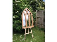 A handmade six gothic arched oak mirror