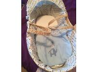 Boys Moses basket. With rocking stand