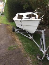 17ft boat. Needs painting. Engine needs repairing also.