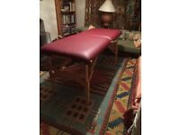 Earthlite Massage Couch. Solid, strong, wide and as new. Has head rest and carry case.